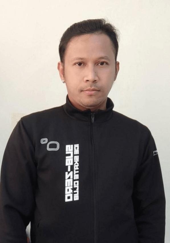 Coach Ji Kraison Niyomvong